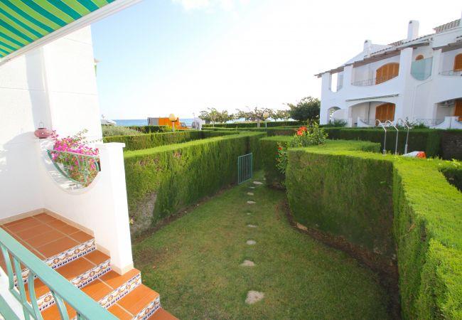 Casa en Hospitalet de L´Infant - C25 ARENAL adosado 1ª línea del mar, piscina, jard