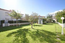 Casa adosada en Miami Playa - BOSQUE21 adosado con jardín BBQ y piscina comun