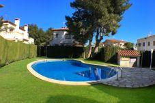 Casa adosada en Miami Playa - RIOJA Adosado jardín, BBQ, piscina y Wifi gratis
