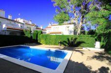 Casa adosada en Miami Playa - BEDOL1 Adosado jardín, piscina comun, WiFi gratis