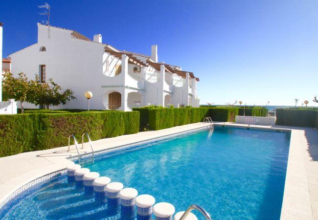 House in Hospitalet de L´Infant - C25 ARENAL adosado 1ª línea del mar, piscina, jard