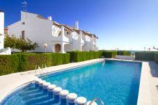Townhouse in Hospitalet de L´Infant - ARENAL adosado 1ª línea del mar, piscina comun