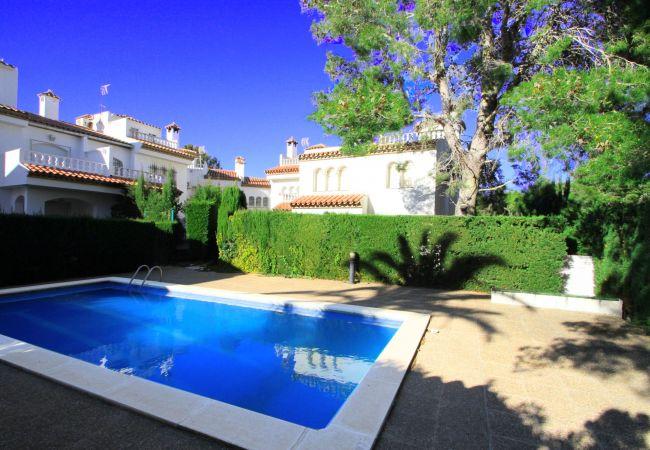 House in Miami Playa - BEDOL1 Adosado jardín, piscina comun, WiFi gratis