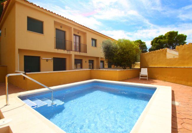 Appartement à Miami Playa - LETICIA adosado con jardín y piscina comun