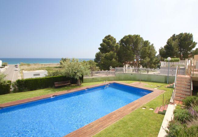 Апартаменты на Hospitalet de L´Infant - PLAYA D'OR Ático con piscina, BBQ y vistas al mar